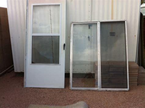 Sliding Patio Storm Door by Aluminum Storm Door Amp Three Aluminum Sliding Glass Windows