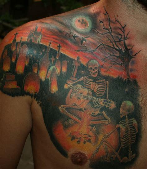 skeletons playing guitar in night graveyard tattoo on