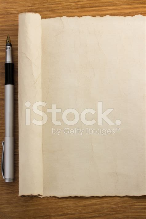 scroll woodwork parchment scroll on wood stock photos freeimages