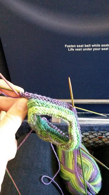 wooden knitting needles on plane travel knitting mumpitz design