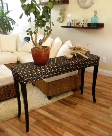 decorating a sofa table this seagrass sofa table is great for entertaining and