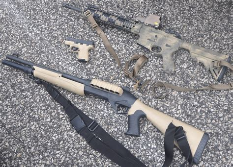 spray painting rifle potd spray painting a rifle a shotgun and a pistol the
