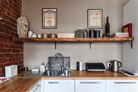 Wooden Kitchen Island Table studio apartment stays authentic by keeping its brick
