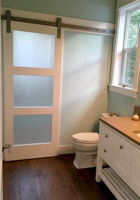 frosted glass barn door frosted glass barn door adds privacy to shower room on