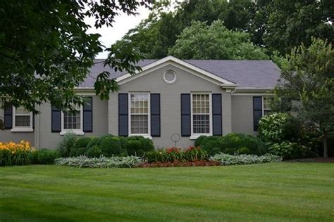 houses painted gray grey painted brick ranch house the color and the