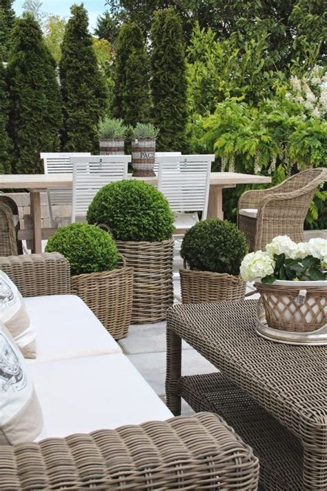 using outdoor furniture inside modern country style using grey rattan kubu chairs in