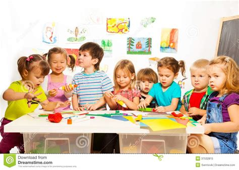 kid classes many drawing and gluing royalty free stock photo