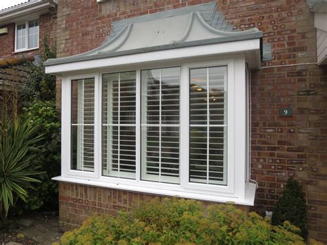 What Is A Cape Cod Style House square bay window shutters fitted in lymington shuttersouth