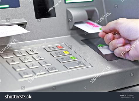 how bank make profit from credit card inserting atm credit card into bank machine to