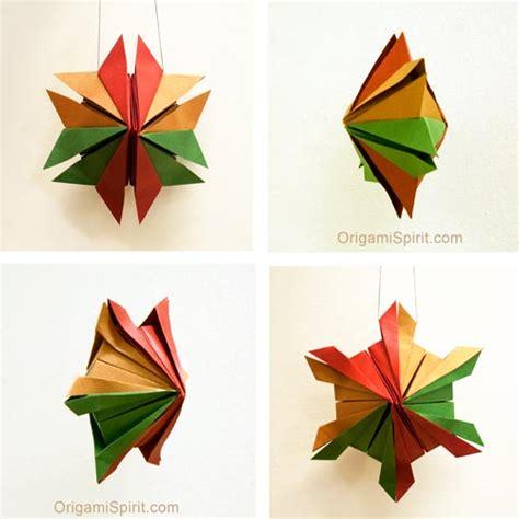 origami snowflake ornaments an origami snowflake
