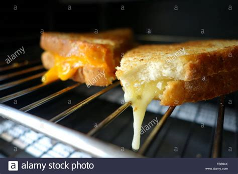 melting in the oven melting cheese sandwich in a toaster oven stock photo