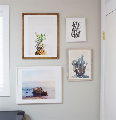 gallery wall designer styling a gallery wall of prints diana elizabeth