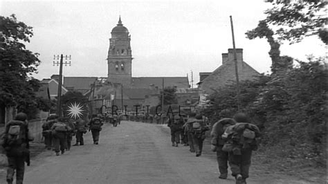 american troops of 1st infantry march into liberated town of st du mont ma hd stock
