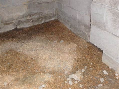 a vented crawl space with a dirt floor