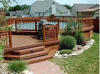 design a deck Deck Landscaping - Planting shrubs and trees around yo...