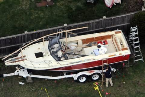 Man Who Found Boston Bomber In Boat by Investigators Look At The Boat Where The Boston Bombing