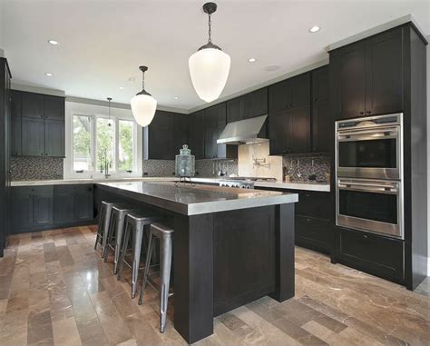 cabinets grey countertops and light wood floors