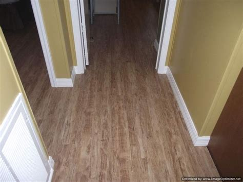 kensington manor laminate flooring flows into hallway and