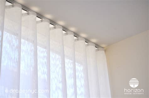 Motorized Curtain Track Canada by Sheer Ripple Fold Curtain On A White Curtain Track