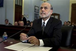 Bernanke defends Fed's interest rate policy at contentious ...