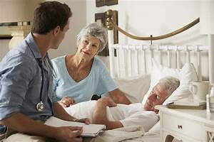 Doctor On Home Visit Discussing Health Of Senior Male ...