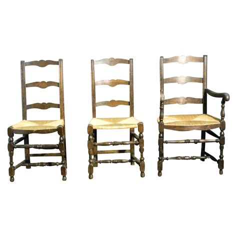 4 antique ladder back dining chairs with seats