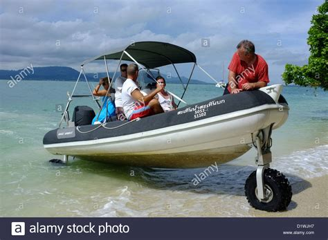 Inflatable Boat With Drive Wheels by Sealegs An Hibious Rigid Inflatable Boat Drives Up The