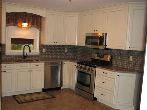 mid continent sullivan maple cabinets in antique white with chocolate glaze are a popular