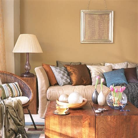 neutral living room with sofa wooden furniture and