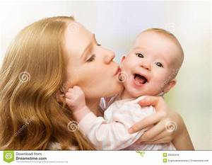 Happy Cheerful Family. Mother And Baby Kissing Stock ...