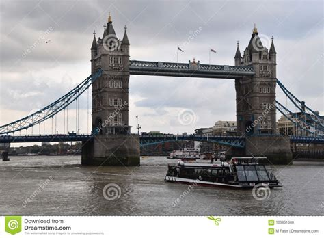 Boat Going Under Tower Bridge by Tower Bridge And Touristic Boat In London Editorial Photo