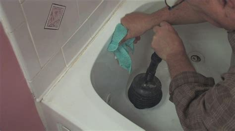 how to clear a clogged sink or tub ehow