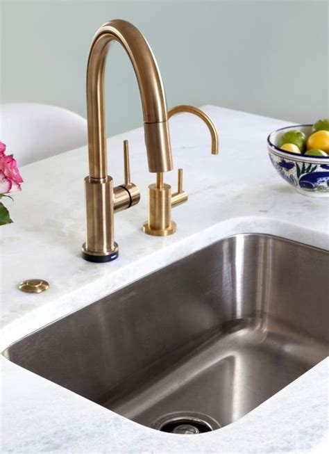 faucets kitchens by design and chagne on