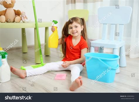 Cute Little Girl Cleaning Her Room Stock Photo 439003852