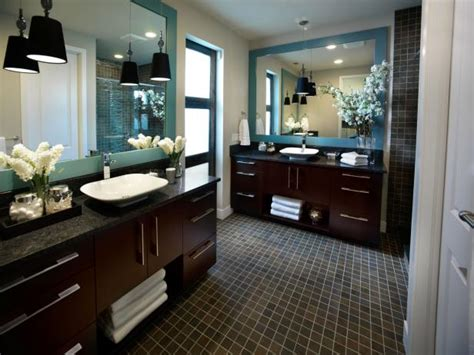 bathroom with contemporary wood vanities blue mirrors and tile floor