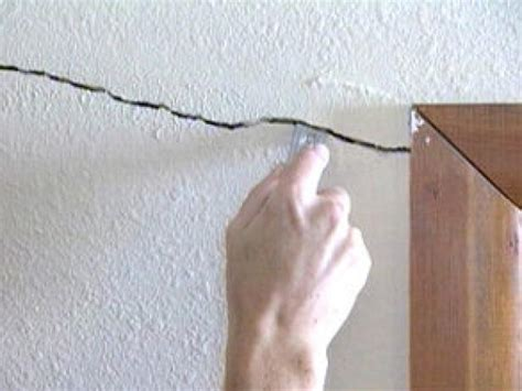 how to repair cracks and holes in drywall how tos diy