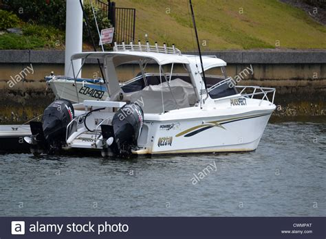 Twin Engine Pontoon by Twin Outboard Boat At A Pontoon On The Canal Stock Photo