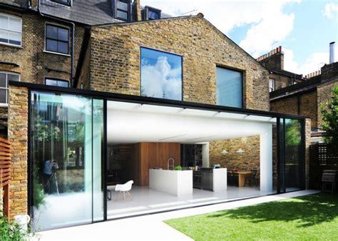 bureau de change joins two houses with a stunning renovation inhabitat