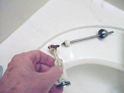 fix a sink stopper 日本語