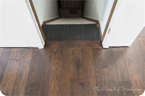 How To Install Engineered Wood Flooring Around Stairs Live Chat Room Video Where To Hang Pictures In Living Sets Naomi The Large Chairs Dark Grey Rooms White And Black Ideas Toy Storage Solutions