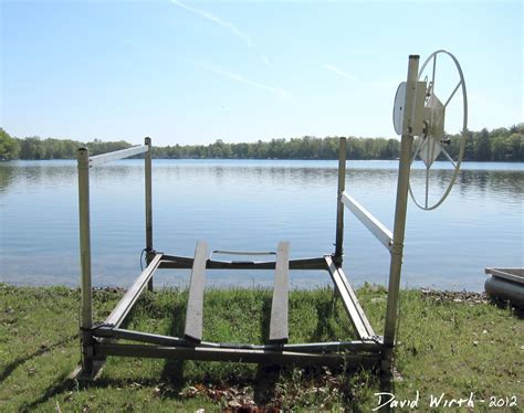 Boat Lift Hand Crank by Cottage On The Lake Putting In The Dock And Boats