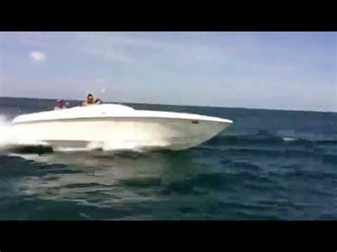 High Performance Ocean Boats by Ripping Across The Ocean In 454 Jaws Speed Boat Jumping