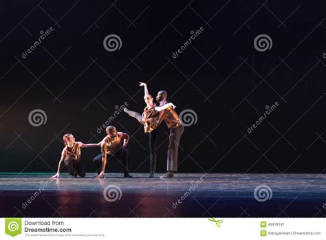 two 2 dancers pose against blue background on stage editorial photo image 49978191