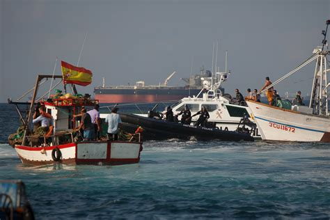 Boat In The Water In Spanish by Gibraltar Navy Standoff With Spanish Fishing Boats