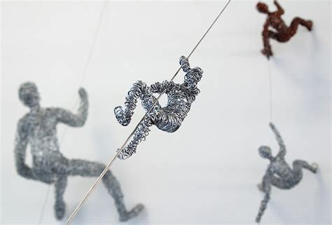 Little Wire People Climbing Everywhere