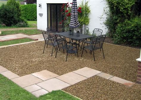 Pea Gravel Patio Designs by Woodchip And Slab Patio My Garden Gravel