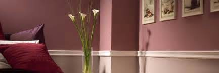 a white two tone chair rail moulding on a wall ideas for