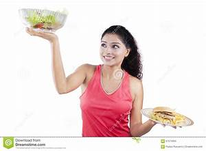 Woman Lifting Healthy Food And Fast Food Stock Photo ...