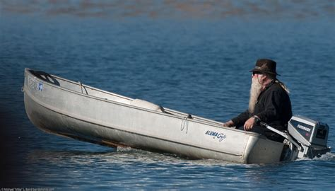 Small Boat Jobs by Old Man With A Very Long Santa Claus Beard Pilots A Small