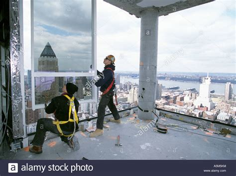 Workers, With Safety Harness Unclipped, Installing Curtain Wall At Stock Photo, Royalty Free How Much Material For Triple Pleat Curtains Cabins Rustic Red And White Gingham Shower Curtain Spode Christmas Tree Hooks Inexpensive Rods Matching Duvet Covers Uk Indian Fabric Inside Dimensions Of Side Trailer